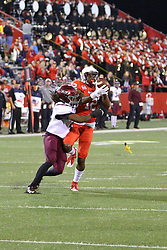15 October 2016:  Christian Gibbs makes a catch while under pressure from the defense. NCAA FCS Football game between Southern Illinois Salukis and Illinois State Redbirds at Hancock Stadium in Normal IL (Photo by Alan Look)