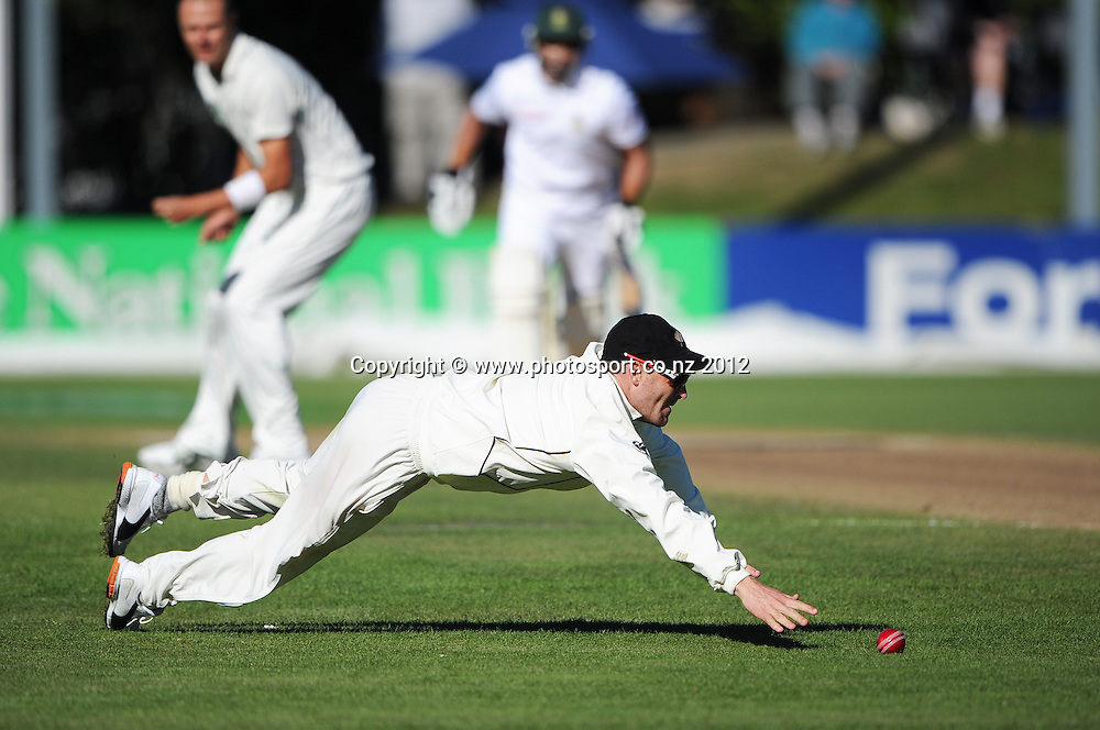 Brendon McCullum dives in the outfield on Day 3 of the first test match between South Africa and New Zealand at the University Oval in Dunedin, New Zealand on Friday 9 March 2012. Photo: Andrew Cornaga/Photosport.co.nz