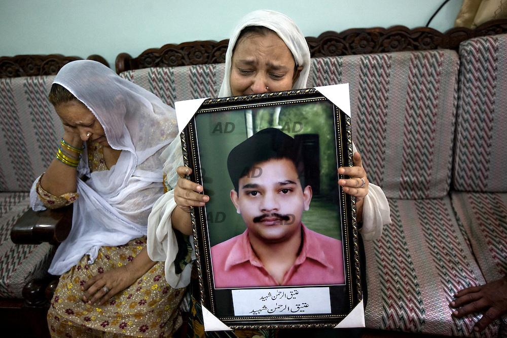 "The family of the activist of the Muttahida Qaumi Movement (MQM) 28-year-old Atiq-ur-Rehman. He was shot dead while two others were injured by unidentified assailants. No one says openly, but everyone thinks and indicate the MQM-H, the rival faction of the MQM. *** General Caption *** Muttahida Quami Movement, generally known as MQM , (""United National Movement"" in English) is an progressive liberal secular centre left party in Pakistan (initially on quasi-socialist lines) founded on 11 June 1978 as a student organization of ""muhajir"" (immigrants), the  All Pakistan Muhajir Students Organization or APMSO, at the University of Karachi by Altaf Hussain who continues to remain its chief. Supposedly it represent the majority of immigrants who migrated from India to Pakistan in 1947. APMSO then gave birth to the Muhajir Quami Movement (MQM) on March 1984. From 1992 to 1994, the MQM was the target of the Pakistan Army's Operation Cleanup leaving hundreds of civilians dead. On July 26, 1997, MQM officially removed the term Muhajir from its name, and replaced it with Muttahida (""United""). In 1992, after the operation ""Clean up"", there was the split with key members of the party: the MQM-H or MQM Haqiqi, the ""real"" MQM, was born. Since then have not stopped the target killing from both sides. The target killing is getting intensified in Karachi with the military's ongoing counterinsurgency operation in Swat and Malakand. The MQM party is, maybe, the worst enemy of the taliban in Pakistan."