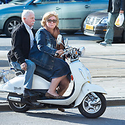 Nederland Rotterdam 21-03-2009 20090321Foto: David Rozing ..Man en vrouw op scooter  People Holland, The Netherlands, dutch, Pays Bas, Europe ..Foto: David Rozing