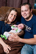 Josh and Anna Duggar with newborn son Michael James, and daughter Mackynzie.