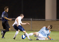 Virginia Cavaliers forward Brian Ownby (27) beats Old Dominion Monarchs goalkeeper Brennan Kirkpatrick (23) to score his second goal of the game.  The Virginia Cavaliers defeated the Old Dominion Monarchs 3-0 in a pre-season NCAA Men's Soccer exhibition game held at Klockner Stadium on the Grounds of the University of Virginia in Charlottesville, VA on August 23, 2008.
