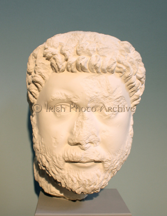 Governor Oecumenius.  From North Agora at Aphrodisias, c. AD 400.  The head belongs to a statue whose inscribed base praises the governor's knowledge of the law, his ability to speak both Greek and Latin, and his purity of mind and hand.  On top of the head, a Christian sculptor covertly marked his faith in three inscribed letters :XMG - Christon Maria genna, 'Christ was born to Mary'.