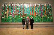 "From left to right Ruth MacKenzie (Director of Cultural Olympiad) Artist David Hockney  and Charles Saumerez_Smith CEO of The Royal Academy of Arts stands in front of his painting called "" The arrival of Spring in Woldgate in East Yorkshire 2011 at The RAA on January 16th 2011...Photo Ki Price."