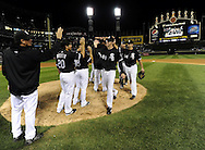 CHICAGO - SEPTEMBER 10:  Chris Sale #49 celebrates with Carlos Quentin #20 and other teammates of the Chicago White Sox after earning a save against the Kansas City Royals on September 10, 2010 at U.S. Cellular Field in Chicago, Illinois.  The White Sox defeated the Royals 4-3.  (Photo by Ron Vesely)