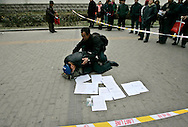 A Chinese Protester cries over the death of a relative as he shows letters detailing his complaints and asks for justice outside of the Foreign Ministry  Beijing, China, Wednesday, Dec.10, 2008. Two dozen people held a bold protest using the 60th anniversary of the declaration of human rights to decry a myriad of alleged government abuses.