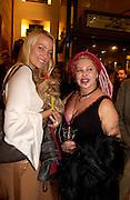 Kaja Wunder and Louise Mazzilli, Art Review Power 100 party, Louis vuitton, 6 November 2003. © Copyright Photograph by Dafydd Jones 66 Stockwell Park Rd. London SW9 0DA Tel 020 7733 0108 www.dafjones.com