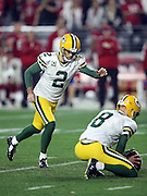 Green Bay Packers punter Tim Masthay (8) holds while Green Bay Packers kicker Mason Crosby (2) kicks a game tying field goal that evens the score at 20-20 at the end of the fourth quarter, forcing overtime during the NFL NFC Divisional round playoff football game against the Arizona Cardinals on Saturday, Jan. 16, 2016 in Glendale, Ariz. The Cardinals won the game in overtime 26-20. (©Paul Anthony Spinelli)