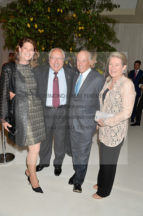 Left to right, URS & FRANCESCA SCHWARZENBACH and MICHEL & CHARLENE DE CARVALHO at a dinner hosted by Cartier in celebration of The Chelsea Flower Show held at The Hurlingham Club, London on 19th May 2014.