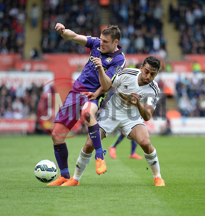 Manchester City's James Milner battles for the ball with Swansea City's Neil Taylor  - Photo mandatory by-line: Alex James/JMP - Mobile: 07966 386802 - 17/05/2015 - SPORT - Football - Swansea - The Liberty stadium - Swansea City v Manchester City - Barclays premier league