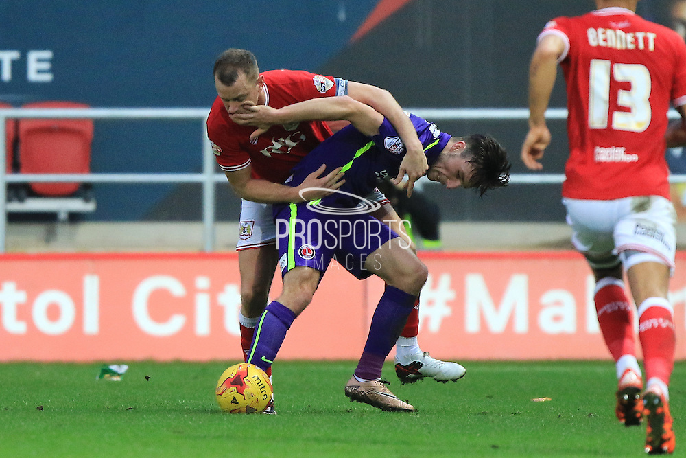 Charlton Athletic defender Morgan Fox and Bristol City forward Aaron Wilbraham during the Sky Bet Championship match between Bristol City and Charlton Athletic at Ashton Gate, Bristol, England on 26 December 2015. Photo by Jemma Phillips.