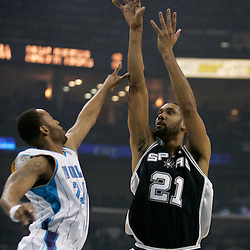 Mar 01, 2010; New Orleans, LA, USA; San Antonio Spurs center Tim Duncan (21) shoots over New Orleans Hornets guard Morris Peterson (24) during the first half at the New Orleans Arena. Mandatory Credit: Derick E. Hingle-US PRESSWIRE