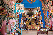 """29 MARCH 2012 - TAY NINH, VIETNAM:   The all seeing eye in the Cao Dai Holy See in Tay Ninh, Vietnam. Cao Dai (also Caodaiism) is a syncretistic, monotheistic religion, officially established in the city of Tây Ninh, southern Vietnam in 1926. Cao means """"high"""" and """"Dai"""" means """"dais"""" (as in a platform or altar raised above the surrounding level to give prominence to the person on it). Estimates of Cao Dai adherents in Vietnam vary, but most sources give two to three million, but there may be up to six million. An additional 30,000 Vietnamese exiles, in the United States, Europe, and Australia are Cao Dai followers. During the Vietnam's wars from 1945-1975, members of Cao Dai were active in political and military struggles, both against French colonial forces and Prime Minister Ngo Dinh Diem of South Vietnam. Their opposition to the communist forces until 1975 was a factor in their repression after the fall of Saigon in 1975, when the incoming communist government proscribed the practice of Cao Dai. In 1997, the Cao Dai was granted legal recognition. Cao Dai's pantheon of saints includes such diverse figures as the Buddha, Confucius, Jesus Christ, Muhammad, Pericles, Julius Caesar, Joan of Arc, Victor Hugo, and the Chinese revolutionary leader Sun Yat-sen. These are honored at Cao Dai temples, along with ancestors.    PHOTO BY JACK KURTZ"""