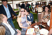 POPPY DELEVIGNE; RICHARD DENNEN, Cartier International Polo. Smiths Lawn. Windsor. 24 July 2011. <br /> <br />  , -DO NOT ARCHIVE-© Copyright Photograph by Dafydd Jones. 248 Clapham Rd. London SW9 0PZ. Tel 0207 820 0771. www.dafjones.com.