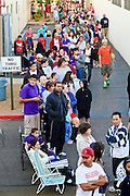 "Oct. 24, 2009 - SCOTTSDALE, AZ: People line up at Scottsdale Healthcare's Community Health Services clinic to get the H1N1 vaccine Saturday morning. The first publicly administered H1N1 (""swine flu"") vaccinations were given in the Phoenix area Saturday. About 52,000 doses of the vaccine, in both injection and nasal spray form, were available on a first come first served basis, but only to those in so called ""high risk"" groups: pregnant women, children 6 months to 4 years old, children 5 years to 18 years with underlying health concerns and direct caregivers of infants less than 6 months old. More than 700 people lined up at Scottsdale Health Care, which had 500 doses of the vaccine to administer.     Photo by Jack Kurtz"
