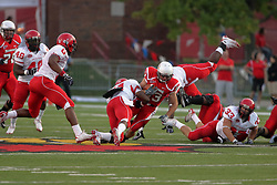 19 September 2009: Jake Knecht gets a gain but is stopped by Tremayne Townsend in a game which the Austin Peay Governors were defeated 38-7 by the Illinois State Redbirds at Hancock Stadium on campus of Illinois State University in Normal Illinois