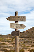 Distance markers with direction pointers signpost on La Isla Graciosa, Lanzarote, Canary Islands, Spain