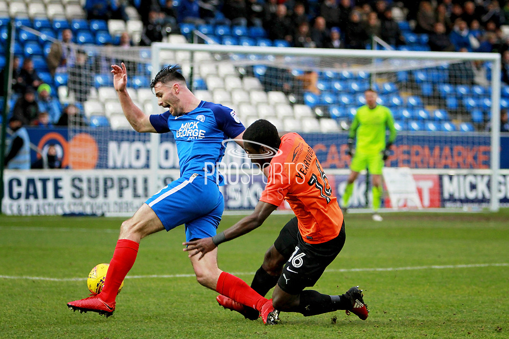 Peterborough United defender Andrew Hughes (3) gets away from Southend United midfielder Dru Yearwood (16) during the EFL Sky Bet League 1 match between Peterborough United and Southend United at London Road, Peterborough, England on 3 February 2018. Picture by Nigel Cole.