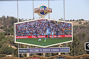LOS ANGELES, CA - JULY 13:  The final match of the 2014 World Cup is broadcast over the stadium scoreboard screen before the Los Angeles Dodgers game against the San Diego Padres at Dodger Stadium on Sunday, July 13, 2014 in Los Angeles, California. The Dodgers won the game 1-0. (Photo by Paul Spinelli/MLB Photos via Getty Images)