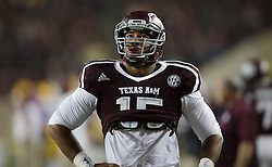 Texas A&M defensive lineman Myles Garrett (15) looks at the score board before the start of an NCAA college football game against LSU Thursday, Nov. 24, 2016, in College Station, Texas. (Sam Craft/The Eagle)