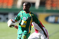 CAPE TOWN, SOUTH AFRICA - 28 MARCH 2010, Njabulo Manqana of Golden Arrows attempts to control the ball head of Granwald Scott  of Ajax Cape Town during the Telkom Knock Out match between Ajax Cape Town and Golden Arrows held at Newlands Stadium in Cape Town, South Africa..Photo by: Shaun Roy/Sportzpics