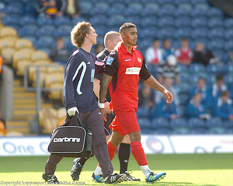 KETTERINGS VERMA COMES OF WITH A CUT HEAD, Mansfield Town v Kettering Town, Blue Square Premier Field Mill, Saturday 27th August 2011