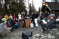 Local residents share stories around a campfire complete with roasted marshmallows during the 2010 Olympic Winter Games in Whistler, BC Canada.
