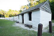 A restored 200 year old slave cabin from the Kingsley Plantation in the Timucuan Ecological & Historic Preserve, Florida. Un-restored cabins are visible in the background. The cabins are made from Tabby, a mixture of oyster shells, sand, and water.
