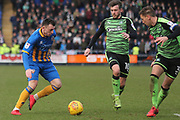 Nathan Thomas of Shrewsbury Town (10) takes on Graham Carey of Plymouth Argyle (10) and Gary Sawyer of Plymouth Argyle (3) during the EFL Sky Bet League 1 match between Shrewsbury Town and Plymouth Argyle at Greenhous Meadow, Shrewsbury, England on 10 February 2018. Picture by Mick Haynes.