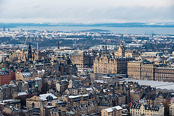 View over city centre of Edinburgh during winter after a snowfall, Scotland, United Kingdom.
