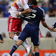 Kenny Cooper, New York Red Bulls, (left) and Austin Berry, Chicago Fire, challenge for the ball during the New York Red Bulls V Chicago Fire Major League Soccer regular season match at Red Bull Arena, Harrison. New Jersey. USA. 6th October 2012. Photo Tim Clayton