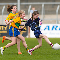 Lucy Power has a shot at goal ahead of her marker Amy Butler.<br /> <br /> Division 1 between Barefield NS and Knockanean NS in the Clare Primary Schools Ladies Football Finals at Cusack Park, Ennis, Co. Clare