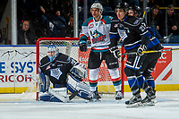 KELOWNA, CANADA - DECEMBER 30: Carsen Twarynski #18 of the Kelowna Rockets looks for the pass between Griffen Outhouse #30 and Chaz Reddekopp #29 of the Victoria Royals on December 30, 2017 at Prospera Place in Kelowna, British Columbia, Canada.  (Photo by Marissa Baecker/Shoot the Breeze)  *** Local Caption ***