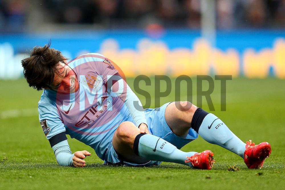 Manchester City's David Silva reacts after picking up an injury - Photo mandatory by-line: Matt McNulty/JMP - Mobile: 07966 386802 - 25/04/2015 - SPORT - Football - Manchester - Etihad Stadium - Manchester City v Aston Villa - Barclays Premier League
