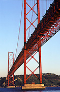 PORTUGAL, LISBON Ponte 25th de Abril, finished in 1966, and one of the world's longest suspension bridges crosses the Tagus River