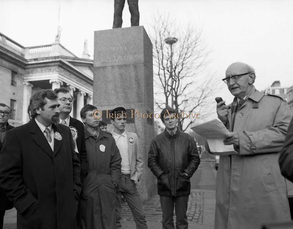 Workers Party Commemoration Of James Larkin.(R50)..1987..07.02.1987..02.07.1987..7th February 1987..A wreath laying ceremony was held today at the memorial for Trade Union leader,James Larkin. The ceremony was conducted the Workers' Party. Mr Tomás McGiolla, leader of the Workers'Party, laid the wreath at the memorial in O'Connell Street, Dublin. The ceremony was held to commomerate the 40th anniversary of the death of James Larkin...Image shows Mr McGiolla reading the oration as the members of the Workers' Party look on.