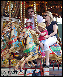 Peter and Autumn Phillips ride on the fair rides with their children Isla and <br /> Savannah (right) Phillips at the Windsor Horse Show. Windsor, United Kingdom. Saturday, 17th May 2014. Picture by Andrew Parsons / i-Images
