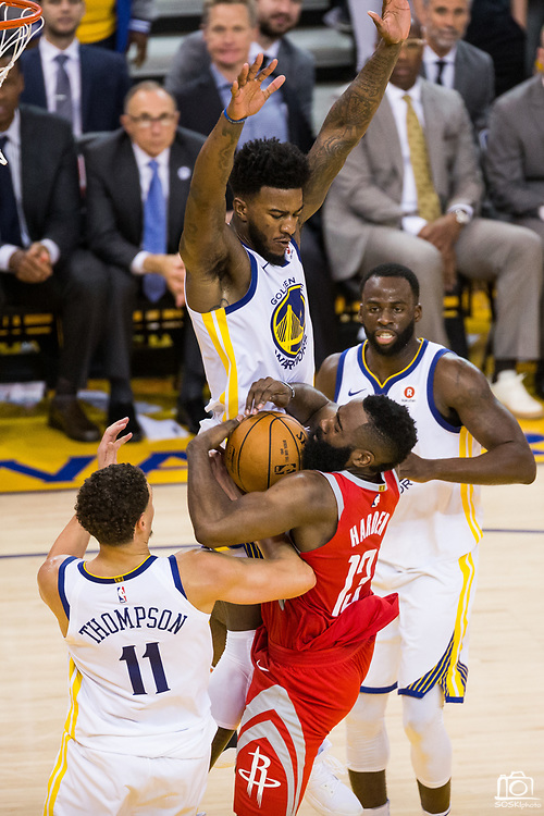 Golden State Warriors center Jordan Bell (2) stops Houston Rockets guard James Harden (13) from scoring a lay up during Game 6 of the Western Conference Finals at Oracle Arena in Oakland, Calif., on May 26, 2018. (Stan Olszewski/Special to S.F. Examiner)