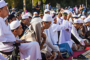 28 JULY 2014 - KHLONG HAE, SONGKHLA, THAILAND: Men and male children wait for Eid services to start at Songkhla Central Mosque in Songkhla province of Thailand. Eid al-Fitr is also called Feast of Breaking the Fast, the Sugar Feast, Bayram (Bajram), the Sweet Festival and the Lesser Eid, is an important Muslim holiday that marks the end of Ramadan, the Islamic holy month of fasting.   PHOTO BY JACK KURTZ