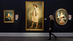 "© Licensed to London News Pictures. 25/11/2016. London, UK. A staff member walks in front of three royal portraits (L to R) ""Nicholas I"" (est GBP 40-60k), ""Prince Paul Demidoff"" (est GBP 40-60k) and ""Grand Duchess Elena Vladimirova"" (est GBP 18-25k), at the preview of artworks from Sotheby's upcoming Russian sales in New Bond Street, where over three hundred works spanning several centuries will be offered. Photo credit : Stephen Chung/LNP"