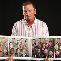THOMAS WELLS | BUY at PHOTOS.DJOURNAL.COM<br /> In the newly released book by President George W. Bush features pull out centerfold collage of injuried veterans and Michael Stafford's portrait is the second image on the top row of the left page. Stafford lost his leg in Iraq to an IED explosion n 2005.
