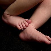 A studio portrait of a newborn baby girls feet. Photo Tim Clayton