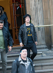 Green Day members Tré Cool, Billie Joe Armstrong and Mike Dirnt, leaving the Blythswood Square Hotel, Glasgow., after the American rock band's concert in front of 35,000 expectant fans at Bellahouston Park, Glasgow, was called off just hours beforehand because of bad weather. Green Day stayed at the Blythswood Square Hotel, Glasgow.