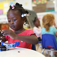 "Lauren Wood | Buy at photos.djournal.com<br /> Gabrielle Weatherspoon, 3, twists apart an Oreo during snack time in Room 7 ""Opening Doors"" Tuesday afternoon at the NMMC Child Care Center."