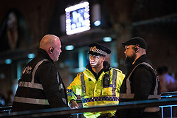 """© Licensed to London News Pictures . 16/11/2015 . Manchester , UK . Police and security at the event . Annual student pub crawl """" Carnage """" at Manchester's Deansgate Locks nightclubs venue . The event sees students visit several clubs over the course of an evening . This year's theme is """" Animal Instinct - unleash your beast """" . Photo credit : Joel Goodman/LNP"""