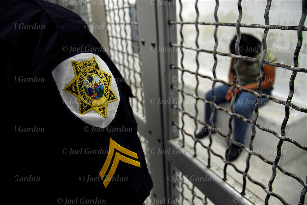 Department of Juvenile Justic Officer looking into holding cell in theJuvenile Justice Center, Ninth Judicial Circuit Court of Florida either waiting to be called before the judge or waiting to be returned to the juvenile detention center in Orlando FL