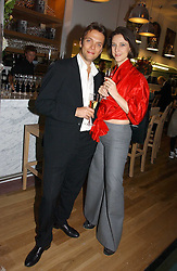 Fashion designer MARIA GRACHVOGEL and MIKE SIMCOCK at the opening party for Tom's Kitchen - the restaurant of Tom Aikens at 27 Cale Street, London SW3 on 1st November 2006.<br />