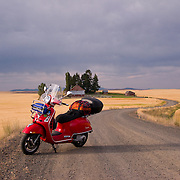 Red Vespa GTS 250 parked on farm road near Davenport, Washington
