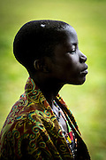 A young Didinga girl in traditional beads and a colourful wrap.
