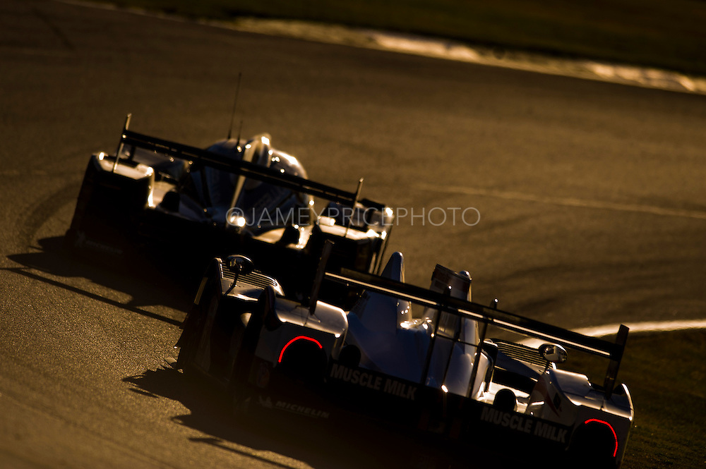 Andrea Belicchi, Neel Jani and Nicolas Prost, Rebellion Racing (P1) Toyota Lola B12/60 chased by Lucas Luhr and Klaus Graf, Muscle Milk Pickett Racing (P1) Honda HDP ARX-03a, Petit Le Mans. Oct 18-20, 2012. © Jamey Price